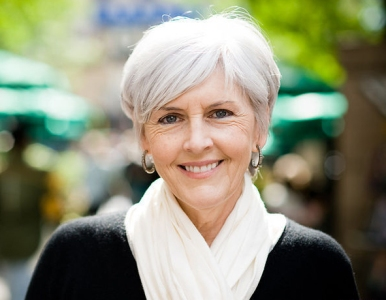 Portrait of a woman with stylish white hair.